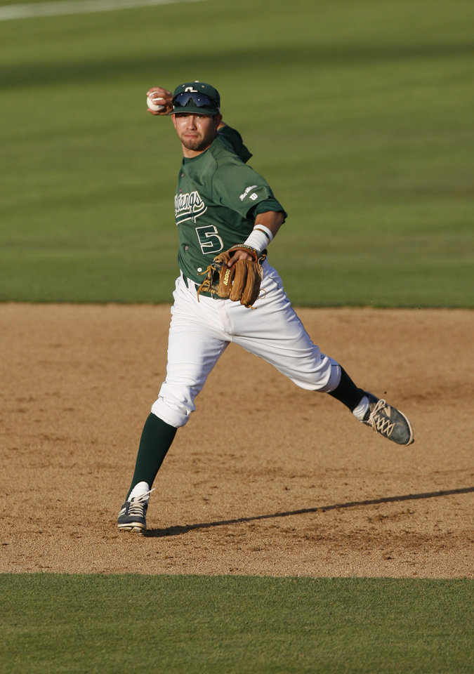 Photo - Cal Poly shortstop Peter Van Gansen throws a runner out at first base during the third inning of an NCAA college baseball tournament regional game against Pepperdine on Sunday, June 1, 2014, at Baggett Stadium at Cal Poly in San Luis Obispo, Calif. (AP Photo/Aaron Lambert)