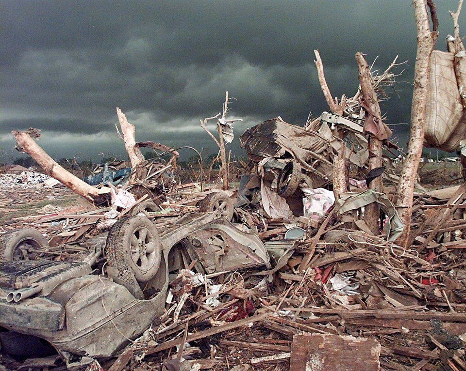 MAY 3, 1999 TORNADO: TORNADO DAMAGE: CARS ARE OVERTURNED  AND BENT AROUND TREES AFTER A TORNADO RIPS THREW MOORE, OK SOUTH   WEST OF 12TH STREET AND SANTA FE MONDAY EVENING.