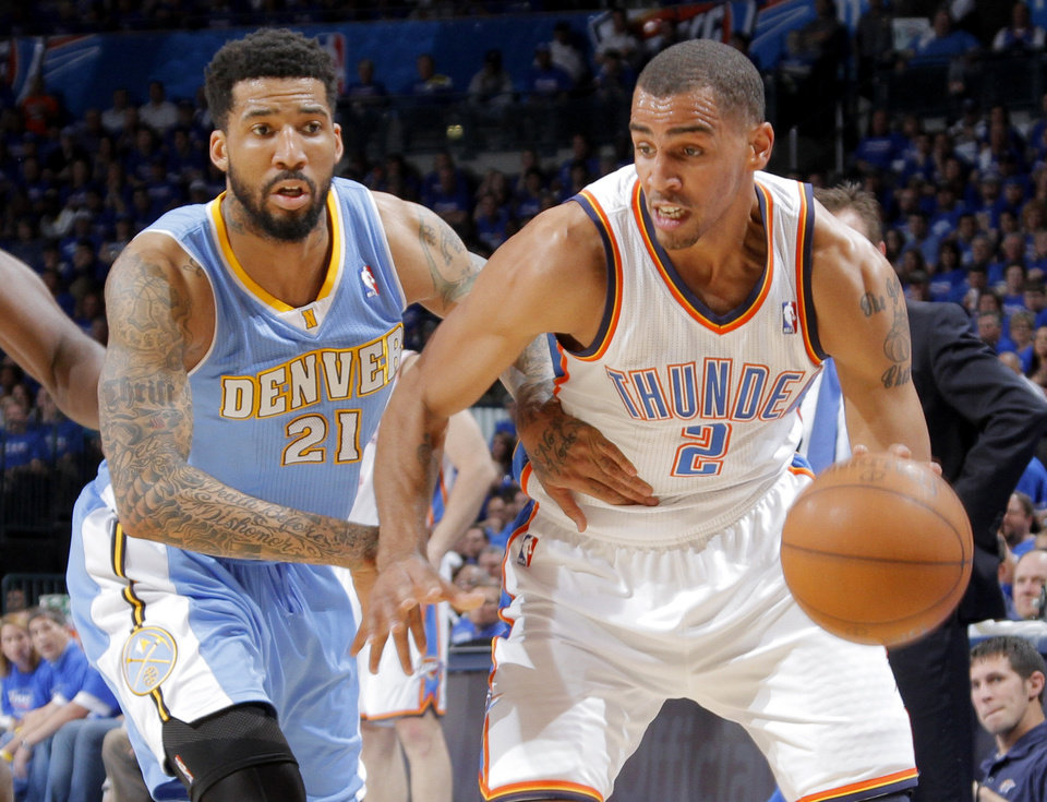 Oklahoma City's Thabo Sefolosha (2) tries to get past Denver's Wilson Chandler (21) during the first round NBA playoff game between the Oklahoma City Thunder and the Denver Nuggets on Sunday, April 17, 2011, in Oklahoma City, Okla. Photo by Chris Landsberger, The Oklahoman