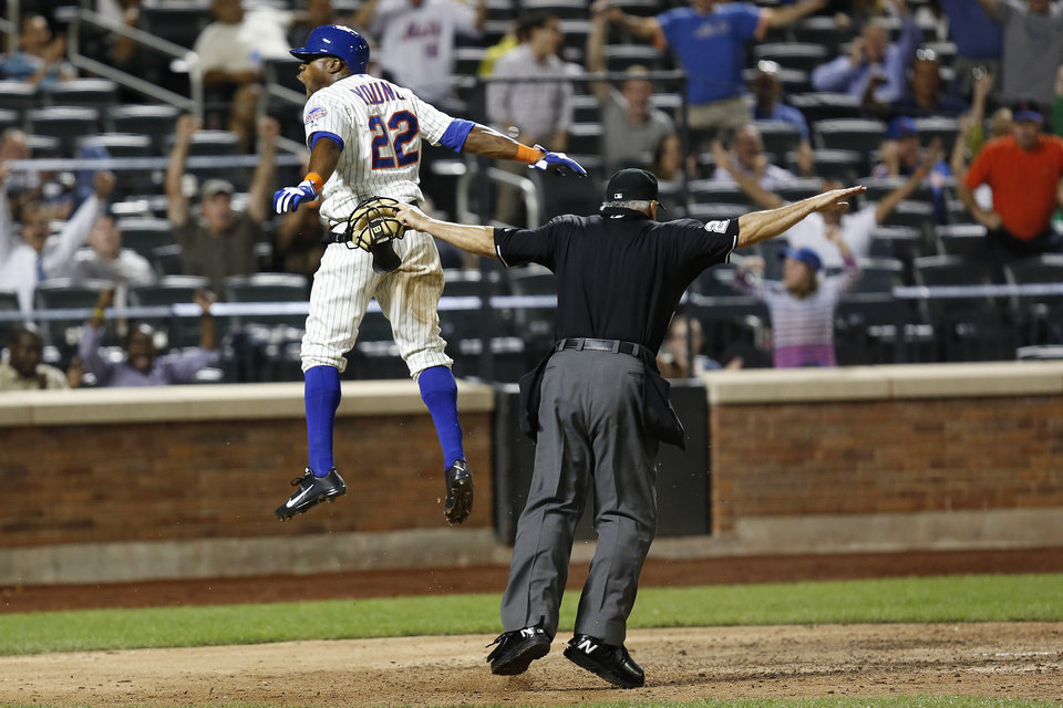 Photo - New York Mets's Eric Young Jr. celebrates after scoring a run in the eighth inning of a baseball game against the Colorado Rockies at Citi Field, Tuesday, Aug. 6, 2013, in New York. (AP Photo/John Minchillo)