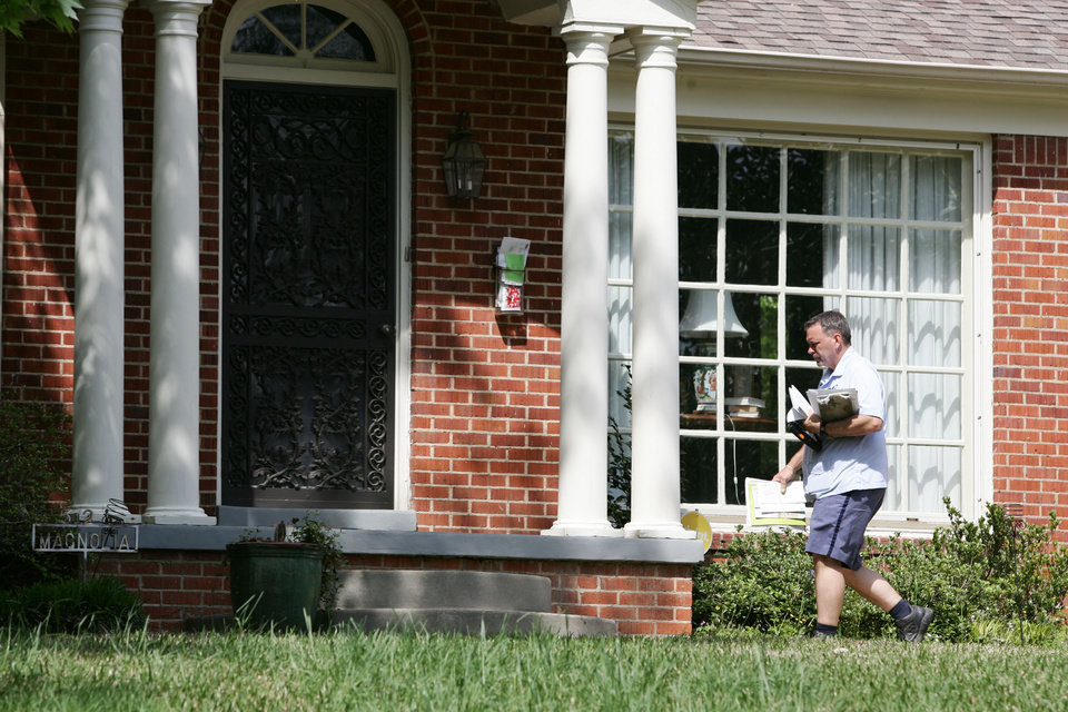 Photo - A U.S. Postal worker makes his way to the front door of Sen. Roger Wicker, R-Miss., in Tupelo, Miss., on Wednesday, April 17, 2013, to deliver his mail. Wicker received a letter at his Washington office Tuesday possibily containing the poison ricin. (AP Photo/Northeast Mississippi, Thomas Wells)