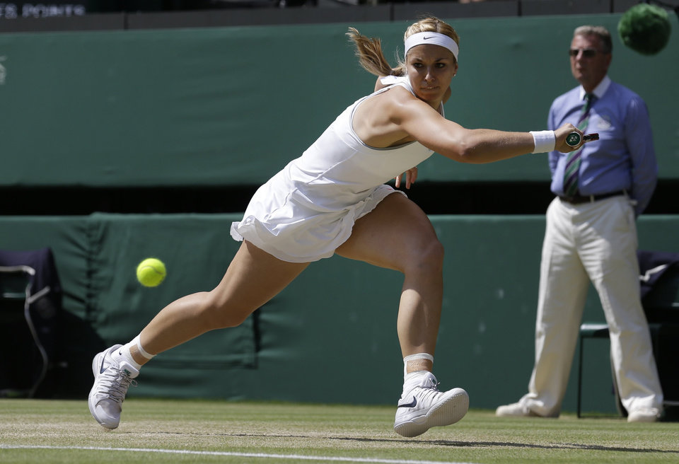 Sabine Lisicki of Germany plays a return to Marion Bartoli of France during their Women's singles final match at the All England Lawn Tennis Championships in Wimbledon, London, Saturday, July 6, 2013. (AP Photo/Anja Niedringhaus)