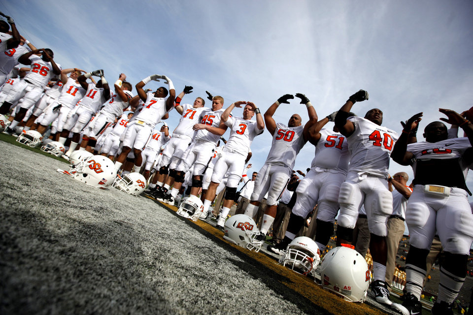 Photo - OSU celebrates their win over Missouri during a college football game between the Oklahoma State University Cowboys (OSU) and the University of Missouri Tigers (Mizzou) at Faurot Field in Columbia, Mo., Saturday, Oct. 22, 2011. Photo by Sarah Phipps, The Oklahoman