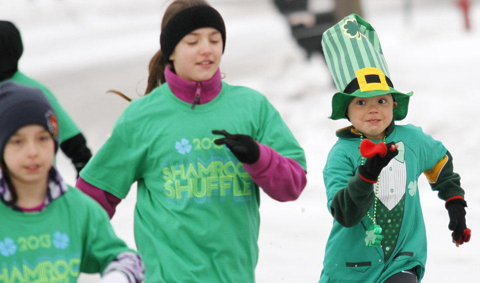 Photo - Kyle Loosen, 7, of the Town of Erin, Wis.  begins the one-mile Leprechaun Race during the Shamrock Shuffle 5K Race/Walk in Hartford on Saturday, March 16, 2013. Proceeds from the race benefited the Hartford Union Varsity Club.  (AP Photo/The Daily News, John Ehlke)