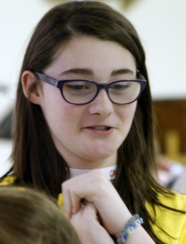 Photo -  Volunteer Gracie Jackson, 12, was in the Joplin tornado and shares her experiences with kids attending Camp Noah on Thursday in Moore. Photo by Steve Sisney, The Oklahoman   STEVE SISNEY -  THE OKLAHOMAN