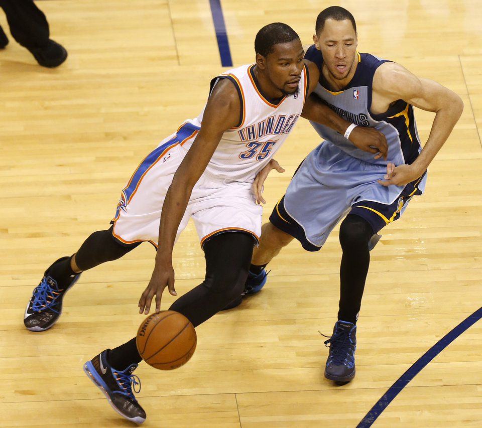 Photo - Oklahoma City's Kevin Durant (35) goes around Memphis' Tayshaun Prince (21) during Game 5 in the first round of the NBA playoffs between the Oklahoma City Thunder and the Memphis Grizzlies at Chesapeake Energy Arena in Oklahoma City, Tuesday, April 29, 2014. Photo by Nate Billings, The Oklahoman