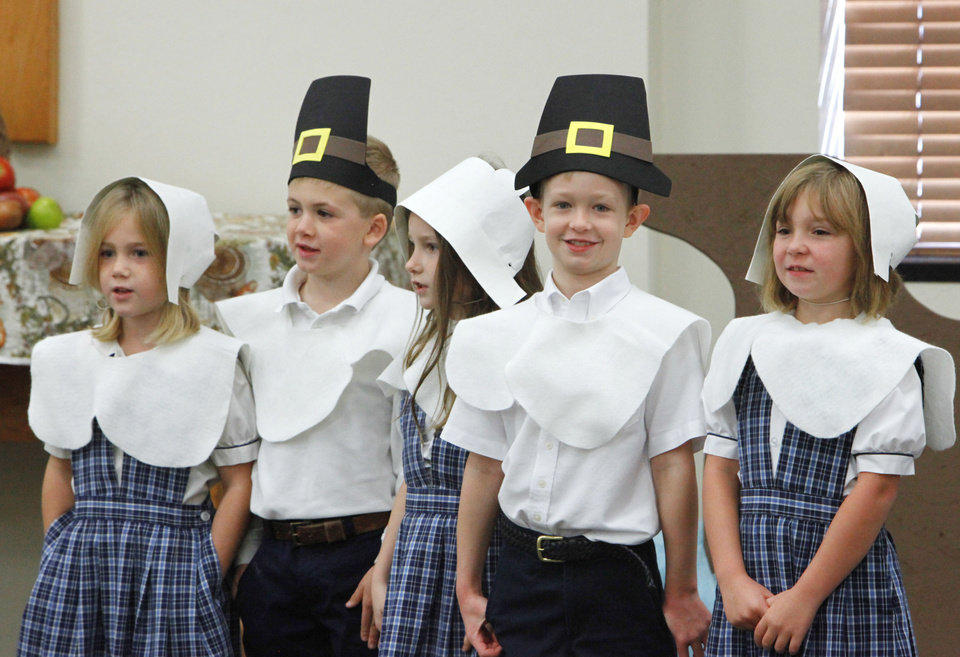 Photo - First-graders Olivia Waters, Braeden Asbury, Sydney Egbert, Austin Pistocco and Megan Reeves sing during a Thanksgiving pageant at St. Mary's Episcopal School.