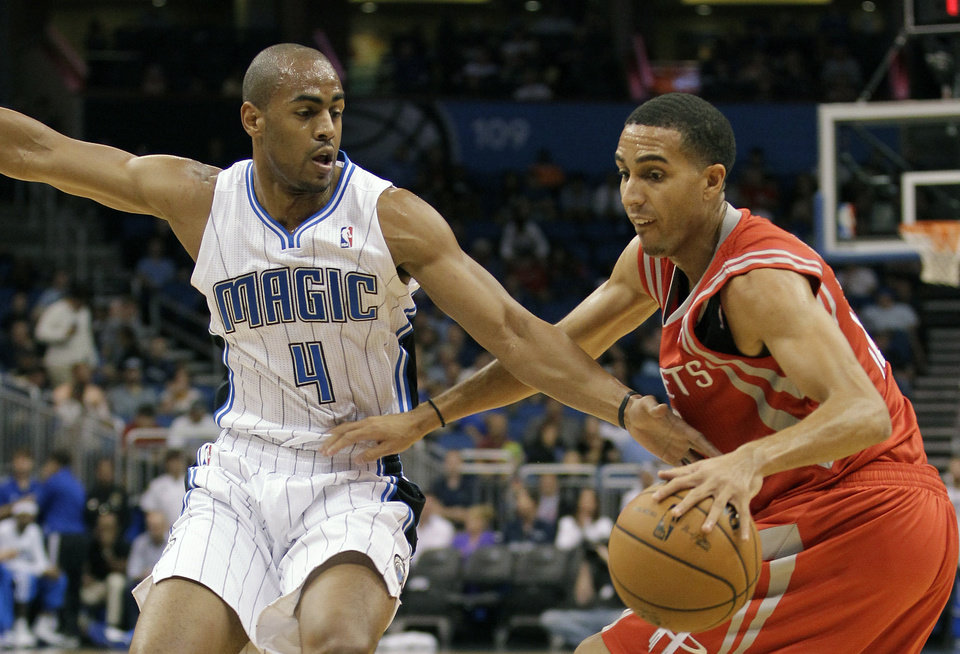 Orlando Magic\'s Arron Afflalo (4) reaches in to try to steal the ball from Houston Rockets\' Kevin Martin, right, during the first half of an NBA preseason basketball game, Friday, Oct. 26, 2012, in Orlando, Fla. (AP Photo/John Raoux) ORG XMIT: DOA106