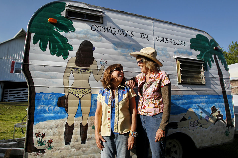 Photo - Members of Sisters on the Fly, Terry Dykstra of Topeka, Kan., left, and Pam Willcott of Linwood, Kan., seen at a gathering in Louisburg, Kansas on April 21, 2012, are proud of the artwork on their camper. Sisters on the Fly is a national group of camping enthusiasts founded by two actual sisters who love fly-fishing in Montana. (Jill Toyoshiba/Kansas City Star/MCT)