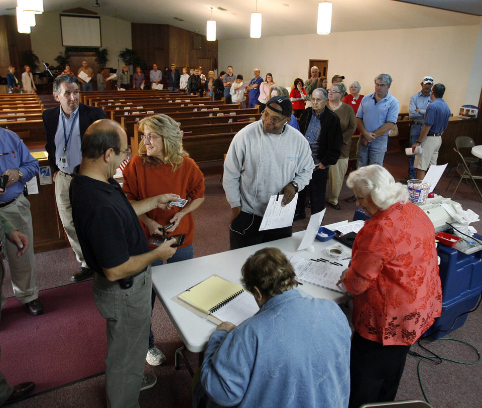 Photo - The crowd has  thinned to one time around the sanctuary by 8:00 am, according to poll official Kay Pirtle at First Baptist Newcastle South Campus Church, on Tuesday, Nov. 4, 2008, in Newcastle, Okla.  Before 7:00 both isles were also filled.  Steve Sisney, The Oklahoman
