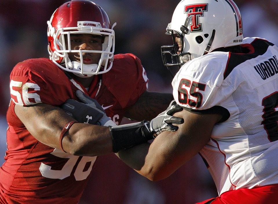 Photo - Oklahoma's Ronnell Lewis (56) takes on Texas Tech's LaAdrian Waddle (65) during the first half of the college football game between the University of Oklahoma Sooners (OU) and the Texas Tech Red Raiders (TTU) at the Gaylord Family Memorial Stadium on Saturday, Nov. 13, 2010, in Norman, Okla.  Photo by Chris Landsberger, The Oklahoman