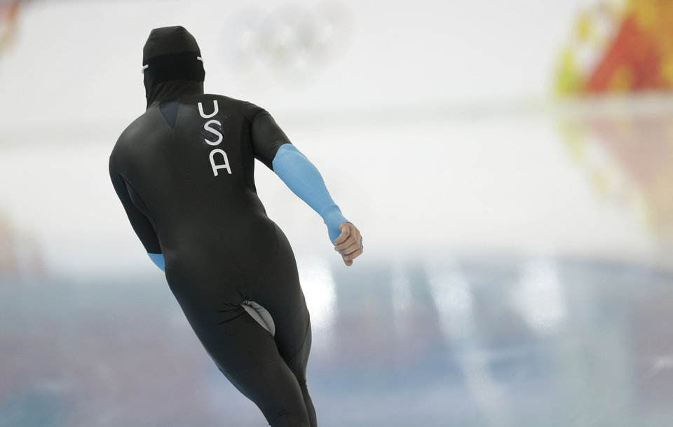 Photo - U.S. speedskater Joey Mantia warms-up wearing the old World Cup race suit, prior to the men's 1,500-meter race at the Adler Arena Skating Center during the 2014 Winter Olympics in Sochi, Russia, Saturday, Feb. 15, 2014. U.S. skaters are looking to bounce back from an awful start to their Olympics by slipping back into their old suits that should have been made obsolete by new high-tech gear. (AP Photo/Patrick Semansky)