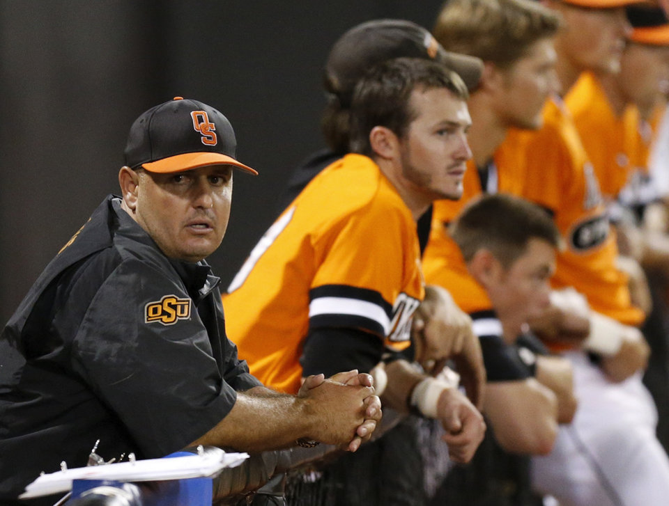 Photo - OSU coach Josh Holliday during Game 2 of the NCAA baseball Stillwater Super Regional between Oklahoma State and UC Irvine at Allie P. Reynolds Stadium in Stillwater, Okla., Saturday, June 7, 2014. Photo by Nate Billings, The Oklahoman