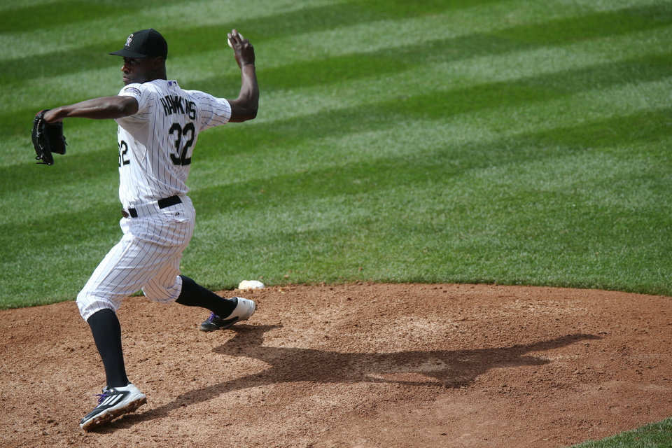Photo - Colorado Rockies relief pitcher LaTroy Hawkins works against the Washington Nationals in the ninth inning of the Rockies' 6-4 victory in a baseball game in Denver on Wednesday, July 23, 2014. (AP Photo)