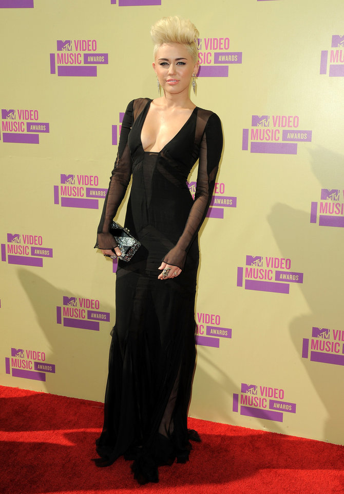 Photo -   FILE - In this Sept. 6, 2012 file photo, Miley Cyrus attends the MTV Video Music Awards in Los Angeles. A Los Angeles jury convicted Jason Luis Rivera, 40, of trespassing and resisting arrest on Thursday Oct. 11, 2012, roughly a month after he was arrested at the singer's home. (Photo by Jordan Strauss/Invision/AP, file)