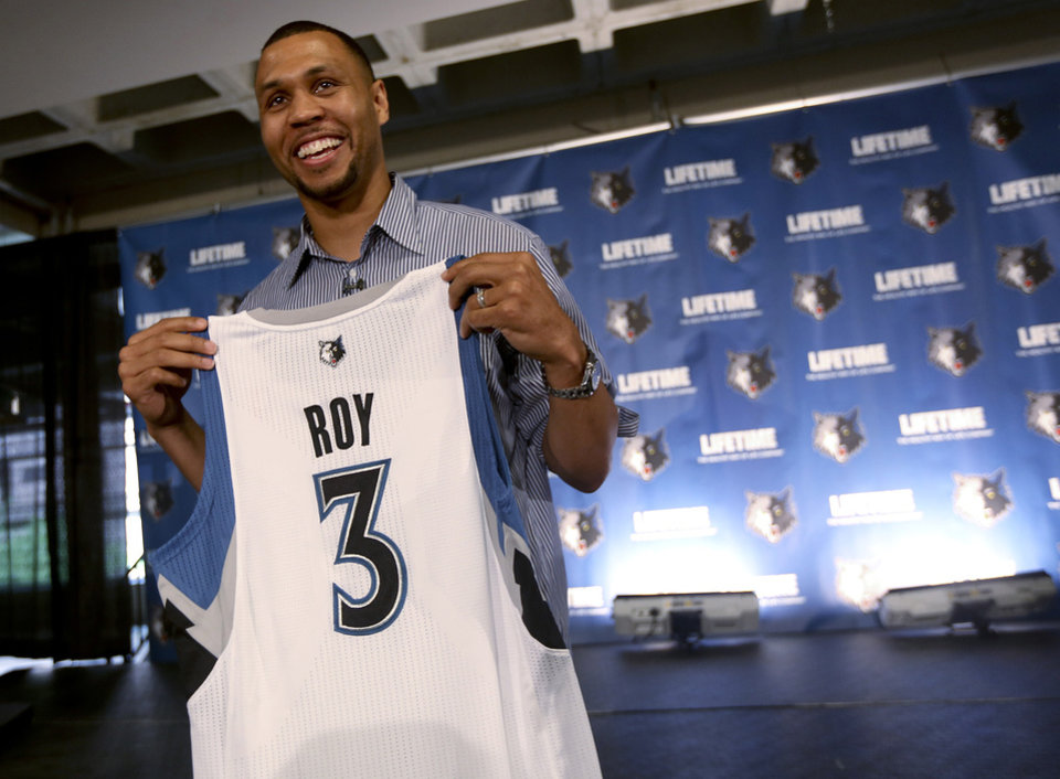 Photo -   FILE - In this July 31, 2012, file photo, Minnesota Timberwolves' Brandon Roy holds up a jersey after a news conference in Minneapolis. Roy worked out with some of his new Timberwolves teammates on Thursday, Sept. 13, 2012, about two weeks before training camp begins. Roy said his body feels better than it has in years.(AP Photo/Star Tribune, Kyndell Harkness, File) ST. PAUL OUT MAGS OUT MINNEAPOLIS-AREA TV OUT