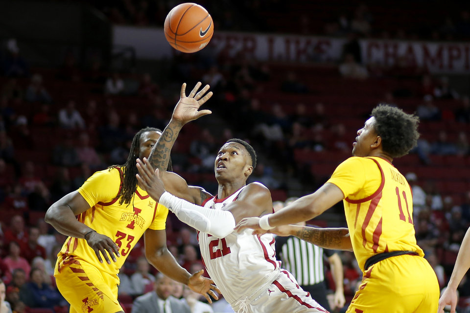 Photo - Oklahoma's Kristian Doolittle (21) puts up a shot from between Iowa State's Solomon Young (33) and Prentiss Nixon (11) during an NCAA basketball game between the University of Oklahoma Sooners (OU) and the Iowa State Cyclones at the Lloyd Noble Center in Norman, Okla., Wednesday, Feb. 12, 2020. [Bryan Terry/The Oklahoman]