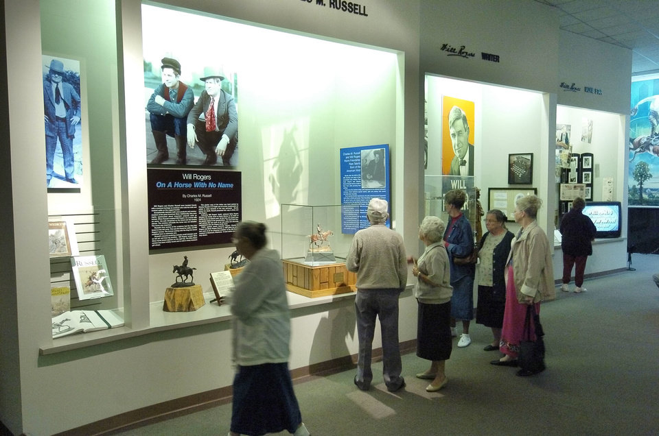 Visitors tour the displays at the Will Rogers Memorial Museums. Photo by Paul Hellstern, The Oklahoman