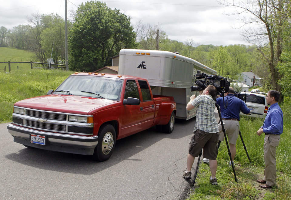 Photo -   A trailer carrying five exotic animals arrives at the farm of Marian Thompson near Zanesville, Ohio Friday, May 4, 2012. The Columbus Zoo returned a bear, two jaguars and two primates to Thompson, the survivors of 56 animals her late Terry Thompson, released from the eastern Ohio farm Oct. 18, 2011, before he committed suicide. Fearing for the public's safety, authorities killed 48 of the animals. (AP Photo/Mark Duncan)