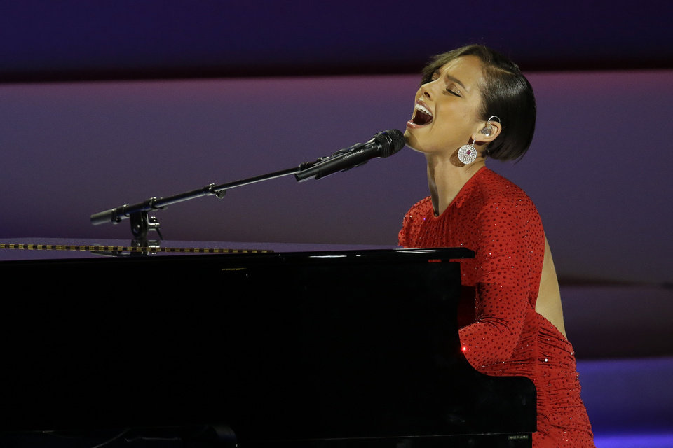 Photo - CORRECTS SPELLING TO ALICIA NOT ALICA- Alicia Keys performs during Inaugural Ball in the Washington Convention Center at the 57th Presidential Inauguration in Washington, Monday, Jan. 21, 2013. (AP Photo/Paul Sancya)