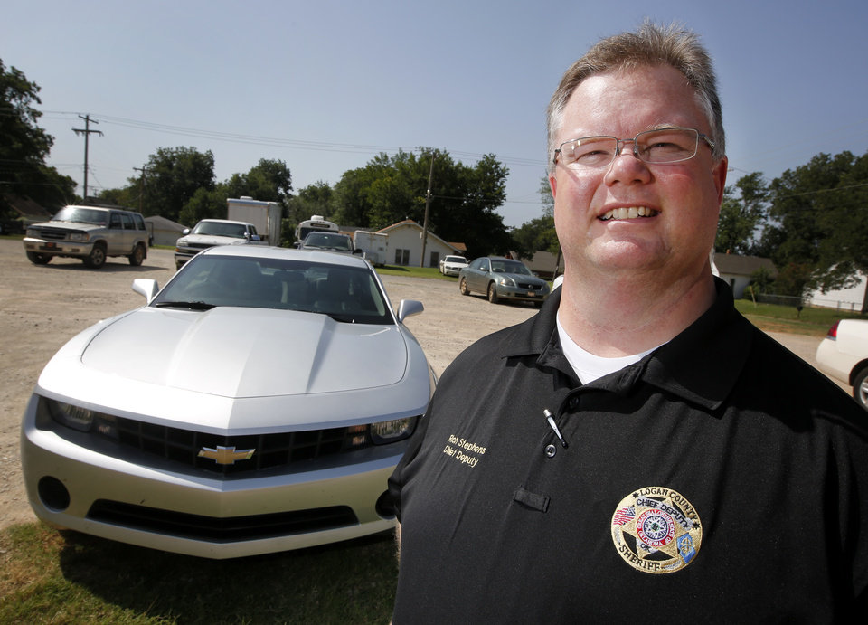 Photo - At right:  Logan County Chief Deputy Richard Stephens says about any car can be converted in to a bait car in about four hours.  Photo By Steve Gooch,  The Oklahoman  Steve Gooch - The Oklahoman