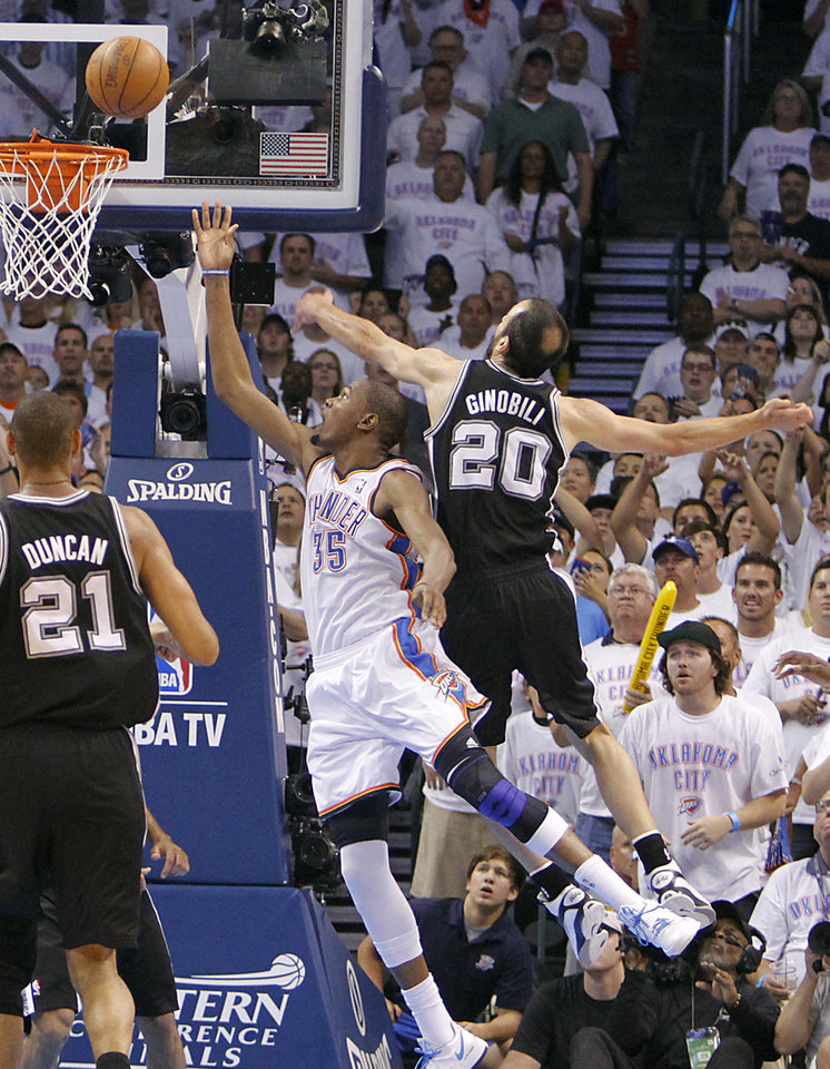 Photo - Oklahoma City's Kevin Durant (35) drives past San Antonio's Manu Ginobili (20) during Game 6 of the Western Conference Finals between the Oklahoma City Thunder and the San Antonio Spurs in the NBA playoffs at the Chesapeake Energy Arena in Oklahoma City, Wednesday, June 6, 2012. Photo by Chris Landsberger, The Oklahoman