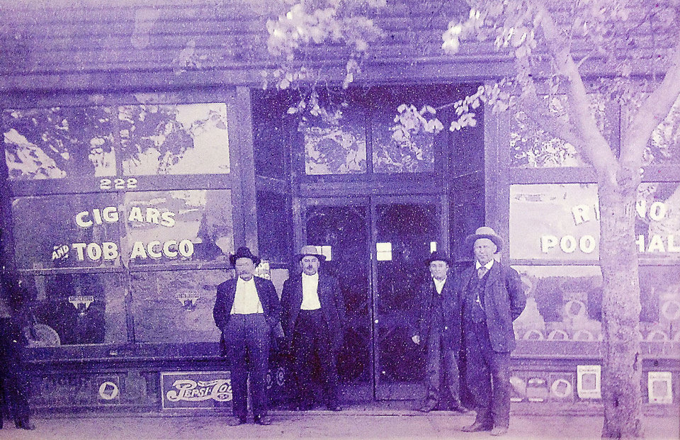Photo - The Hopes' grandfather, D.M. Chandler, and buddies at his old pool hall at 222 W Reno, current site of Myrid Botanical Gardens. Chandler and his brother and sister claimed two residential properties and one business property during a land run in 1889. Photo by Zeke Campfield, The Oklahoman  Zeke Campfield