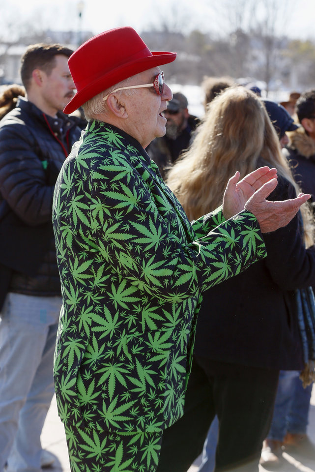 Photo - John Blackwell of Claremore, Okla., applauds during March the Capitol 2020 at the state Capitol in Oklahoma City, Thursday, Feb. 6, 2020. The rally was to protest many of the bills filed in the legislative session that would affect medical marijuana patients and businesses. [Nate Billings/The Oklahoman]