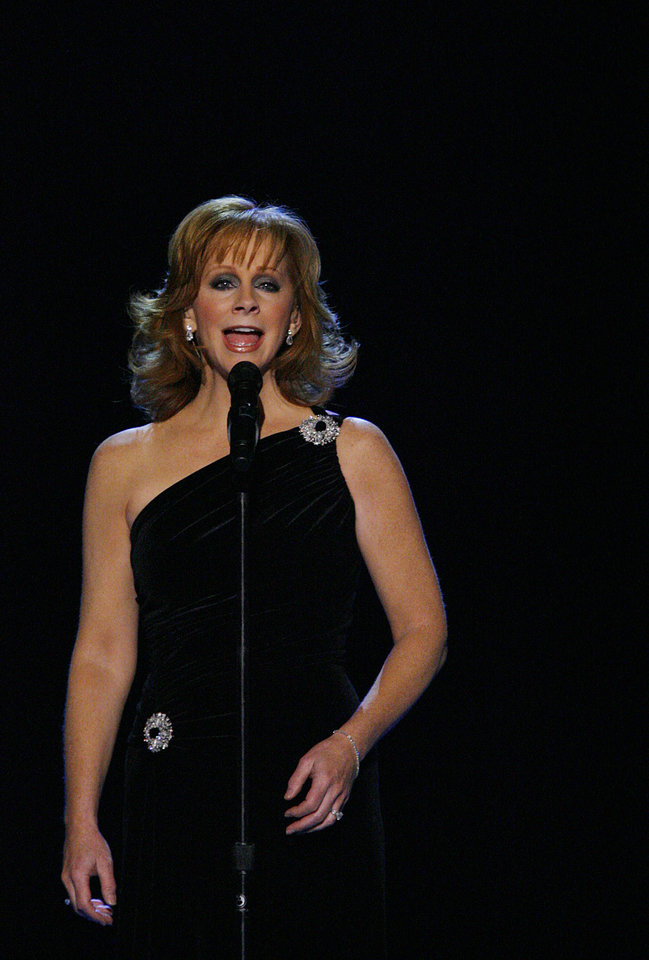 Photo - Reba McEntire performs during the Centennial Spectacular to celebrate the 100th birthday of the State of Oklahoma at the Ford Center on Friday, Nov. 16, 2007, in Oklahoma City, Okla. Photo By CHRIS LANDSBERGER, The Oklahoman