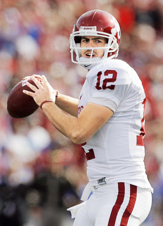 Photo - OU quarterback Landry Jones is one half of OU's most famous couple. Photo by Nate Billings, The Oklahoman