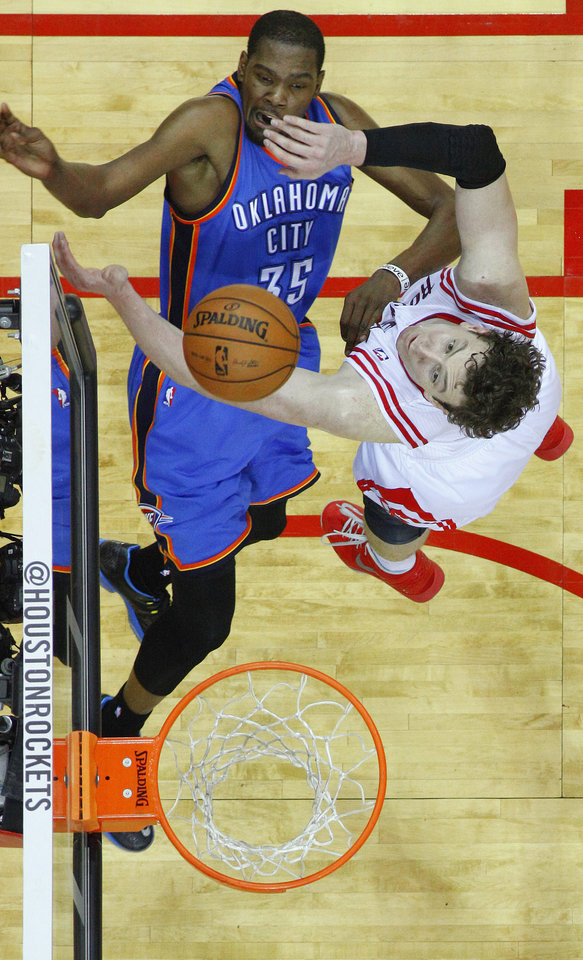 Photo - Oklahoma City's Kevin Durant (35) watches his shot as Houston's Omer Asik (3) defends during Game 6 in the first round of the NBA playoffs between the Oklahoma City Thunder and the Houston Rockets at the Toyota Center in Houston, Texas, Friday, May 3, 2013. Oklahoma City won 103-94. Photo by Bryan Terry, The Oklahoman