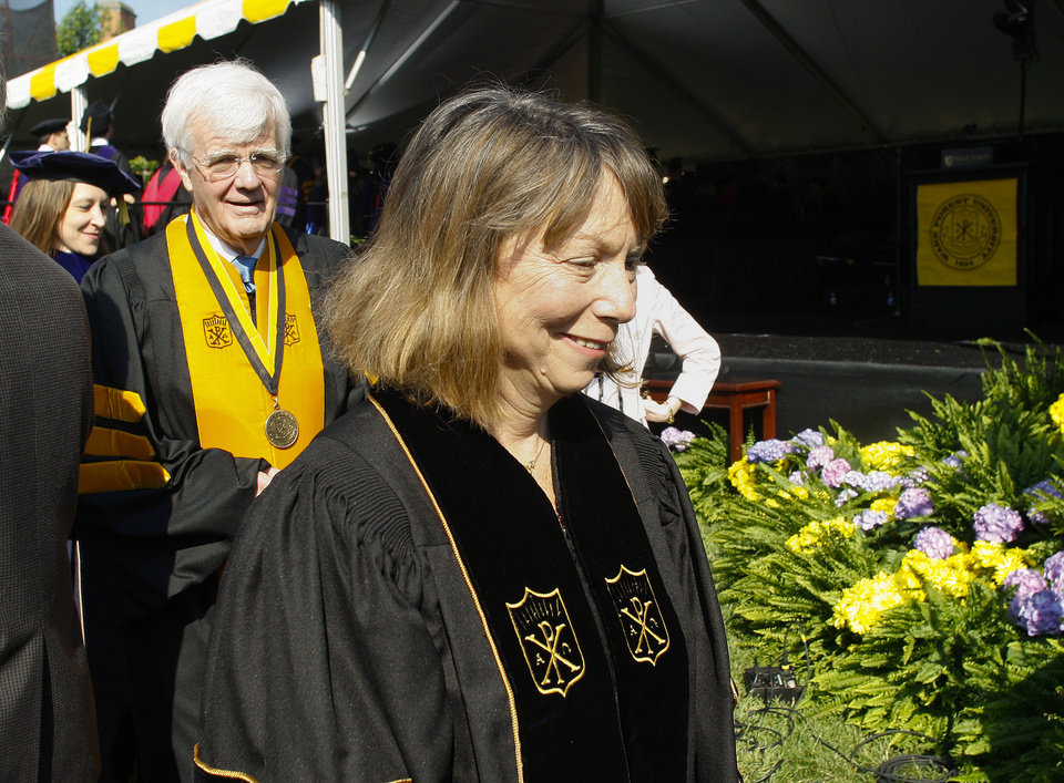 Photo - Jill Abramson, former executive editor of The New York Times, walks with the processional at the commencement ceremony at Wake Forest University in Winston-Salem, N.C., Monday, May 19, 2014.