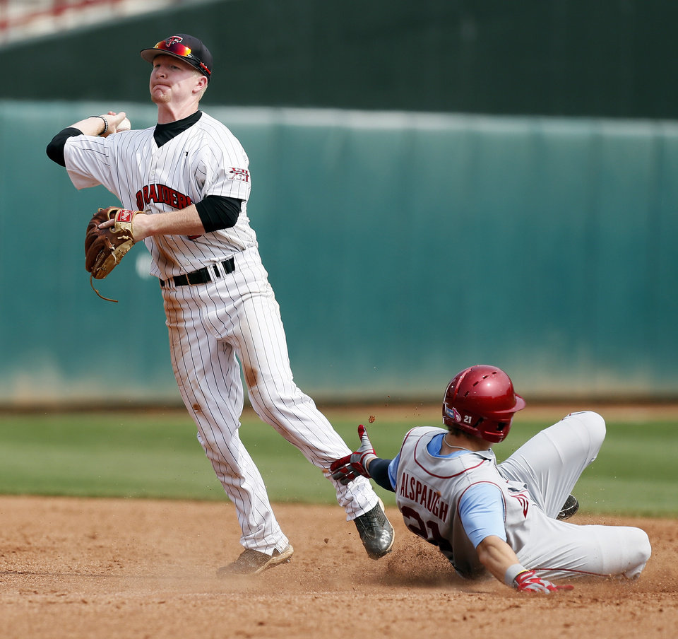 Photo - OU's Taylor Alspaugh (21) is out at 2nd base as Texas Tech's Bryant Burleson (9) throws to 1st base in the 7th inning during an NCAA baseball game between Oklahoma and Texas Tech in the Big 12 Baseball Championship tournament at the Chickasaw Bricktown Ballpark in Oklahoma City, Friday, May 24, 2013. OU won 8-0. Photo by Nate Billings, The Oklahoman