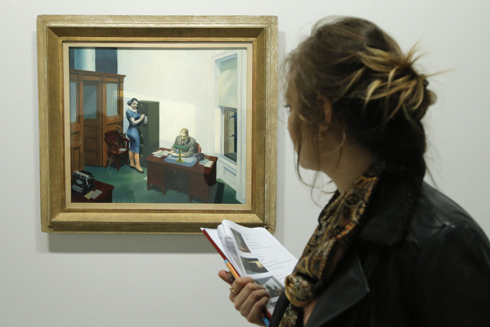 "A woman looks at ""Office at night, 1940"" as part of the retrospective of Edward Hopper works, one of the great American 20th century artists at Paris� Grand Palais Museum, in Paris, Monday, Oct. 8, 2012. This major Hopper retrospective reveals that the 20th century painter known for his rendering of American life, also drew inspiration from France, and includes some 128 Hopper works, such as the masterpieces �Nighthawks� and �Soir Bleu�.(AP Photo/Francois Mori)"