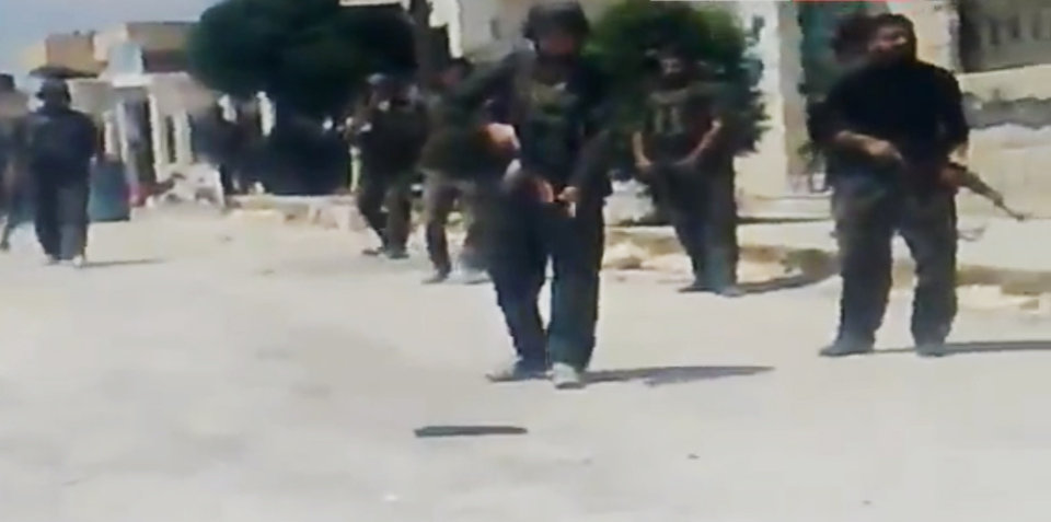 Photo -   In this image made from amateur video released by Ugarit News and accessed Tuesday, May 15, 2012, purports to show Syrian government forces shooting toward people in Idlib, Khan Sheikhoun, Syria. A team of international observers were evacuated Wednesday from a tense town in northern Syria a day after their convoy was hit by a roadside bomb, a U.N. spokesman said. The team's vehicles were struck by the blast Tuesday during a mission in the northern town of Khan Sheikhoun. (AP Photo/Ugarit News via AP video) TV OUT, THE ASSOCIATED PRESS CANNOT INDEPENDENTLY VERIFY THE CONTENT, DATE, LOCATION OR AUTHENTICITY OF THIS MATERIAL