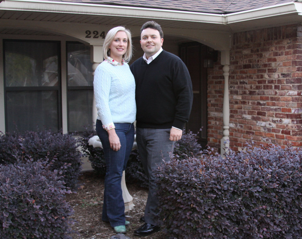 Photo - Alexis and Brian Lux are shown at their home on NW 43. They moved here from North Canton, Ohio, in 2008 and rented until they could buy a home last summer, all the while continue to own, and rent out, the house they left behind. Photo provided   - PROVIDED