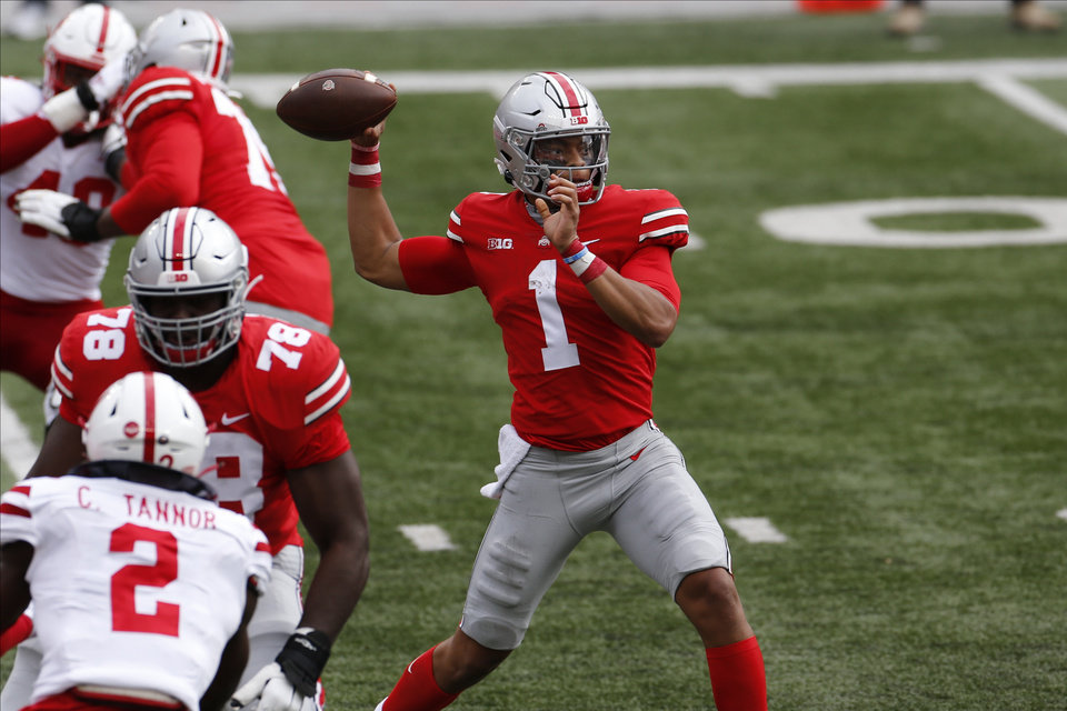 Photo - Ohio State quarterback Justin Fields throws a pass against Nebraska during the first half of an NCAA college football game Saturday, Oct. 24, 2020, in Columbus, Ohio. (AP Photo/Jay LaPrete)