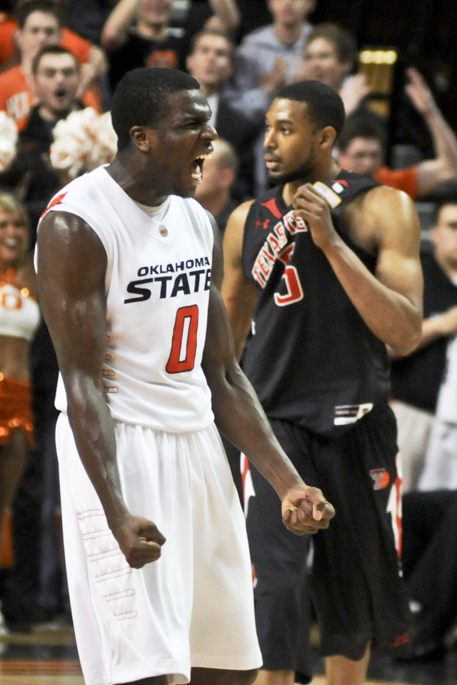 Photo - Oklahoma State guard Jean-Paul Olukemi celebrates after Texas Tech turned the ball over in a win against Texas Tech on Saturday, Feb 26, 2011. ZACH GRAY/Tulsa World