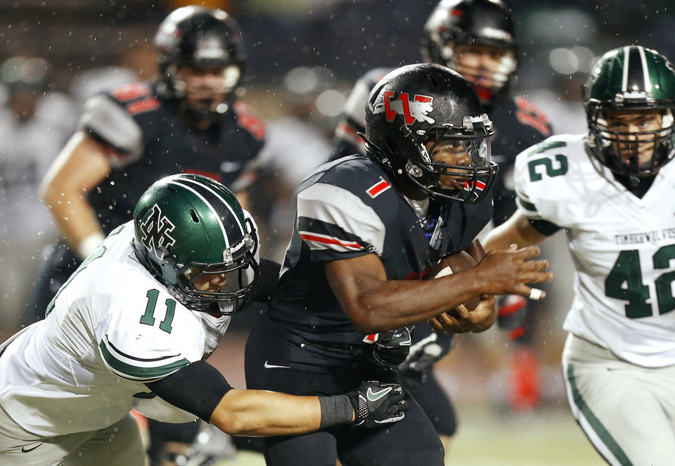 Photo - Norman North's DJ Gasso brings down  Westmoore's Kieron Hardrick during a high school football game in Moore, Okla., Thursday, September 13, 2012. Photo by Bryan Terry, The Oklahoman