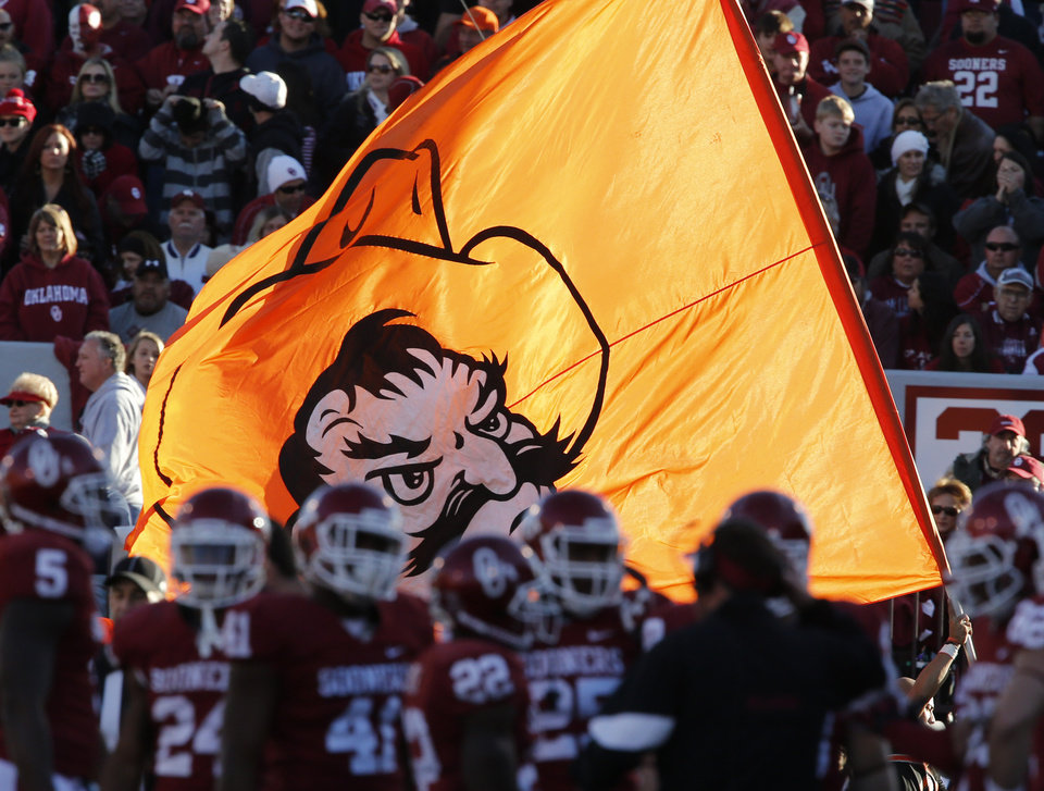 Photo - The Cowboy Pistol Pete flag marks a touchdown during the Bedlam college football game between the University of Oklahoma Sooners (OU) and the Oklahoma State University Cowboys (OSU) at Gaylord Family-Oklahoma Memorial Stadium in Norman, Okla., Saturday, Nov. 24, 2012. Photo by Steve Sisney, The Oklahoman