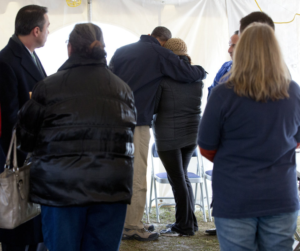 Photo -   President Barack Obama comforts a woman at the FEMA recovery center on the grounds of New Dorp High School, Thursday, Nov. 15, 2012, on Staten Island, in New York. (AP Photo/Carolyn Kaster)