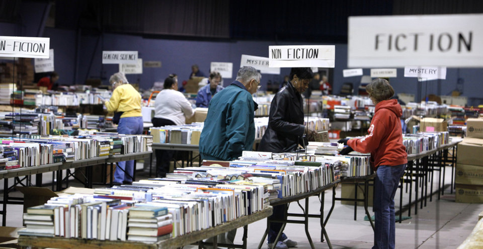 Photo - Volunteers stacking books on tables Tuesday, Feb. 16, 2010, for the annual Friends of the Library book sale this weekend in Oklahoma City. Photo by Paul B. Southerland, The Oklahoman