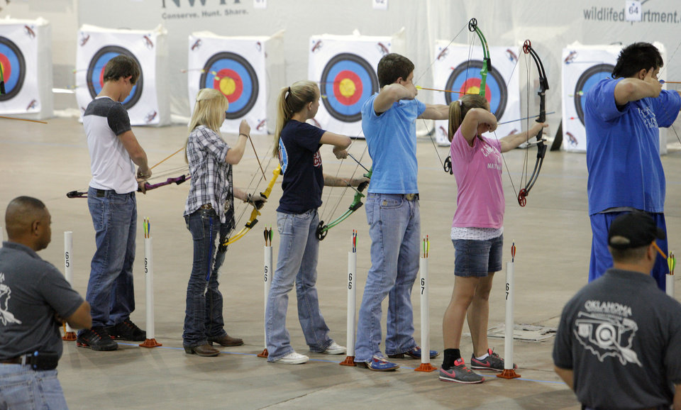 Students shooting in the 10 meter during the Oklahoma\'s National Archery in the Schools Program State Shoot at State Fair Park in Oklahoma City Wednesday, March 28, 2012. Photo by Paul B. Southerland, The Oklahoman
