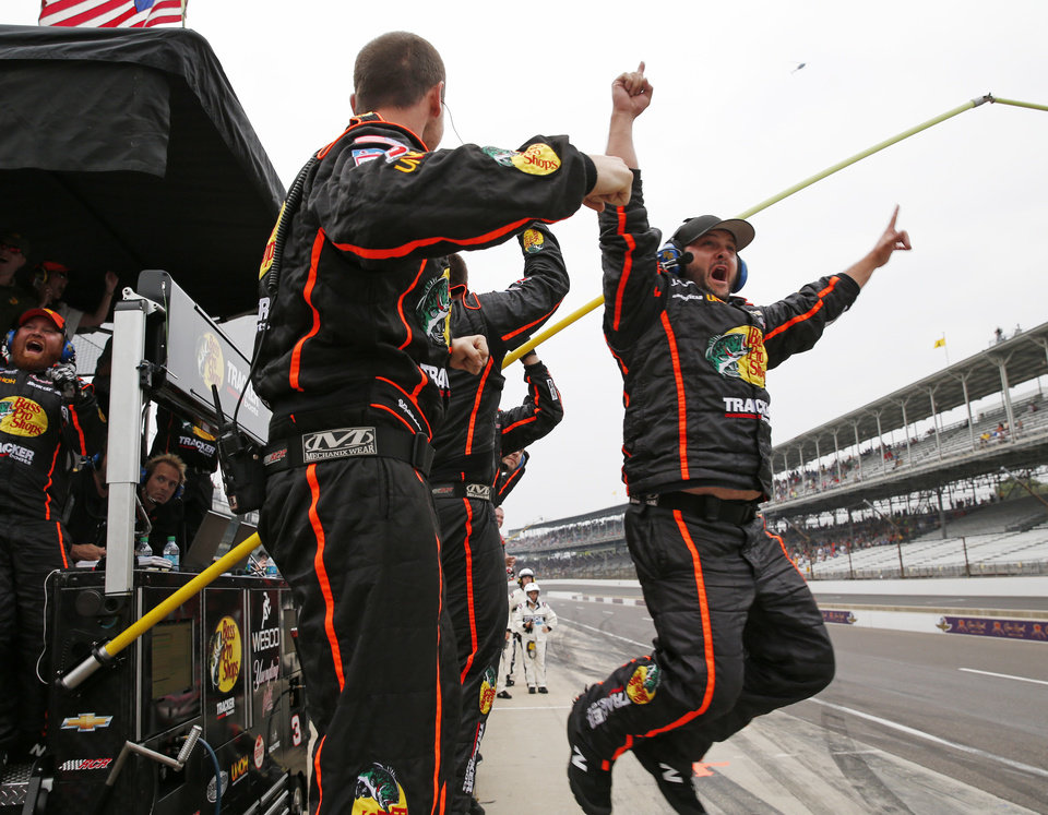 Photo - The crew for Ty Dillon celebrates after Dillon won the NASCAR Nationwide series auto race at Indianapolis Motor Speedway in Indianapolis, Saturday, July 26, 2014. (AP Photo/Robert Baker)