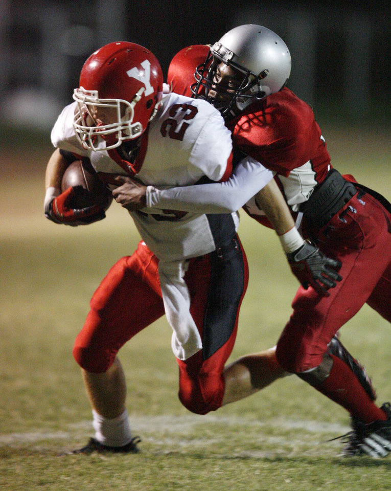 Derek Deeds (23) is tackled by Dylan Johnson (31) as U.S. Grant plays Yukon at C.B. Speegle Stadium on October 2, 2009 in Oklahoma City, Okla.     Photo by Steve Sisney, The Oklahoman
