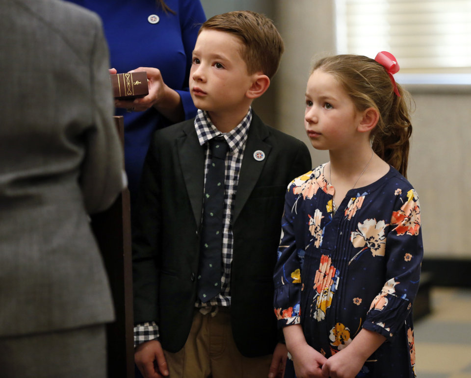 Photo - Mayor David Holt's children George, 8, and Maggie, 6, stand at his side as he is sworn in as the city's 36th mayor on Tuesday, April 10, 2018 in Oklahoma City, Okla.  Photo by Steve Sisney, The Oklahoman