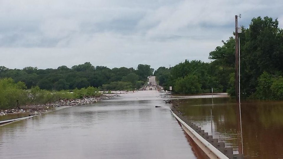 Photo - Trapped on the east side of Twin Bridges of Lake Thunderbird in our neighborhood -- Photo via Julie Dolph @gottarun31 on Twitter