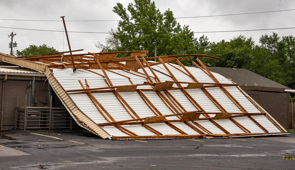 Photo - Strong storms pulled the roof off of the House of Prayer located 3930 SE 27th St. in Del City, Okla. on Tuesday, Aug. 27, 2019.   [Chris Landsberger/The Oklahoman]