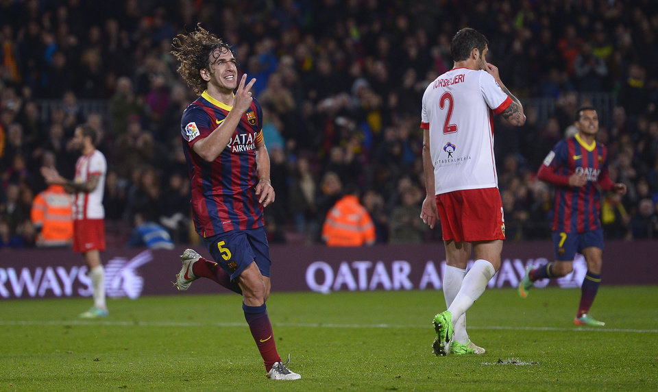 Photo - FC Barcelona's Carles Puyol reacts after scoring against Almeria during a Spanish La Liga soccer match at the Camp Nou stadium in Barcelona, Spain, Sunday, March 2, 2014. (AP Photo/Manu Fernandez)