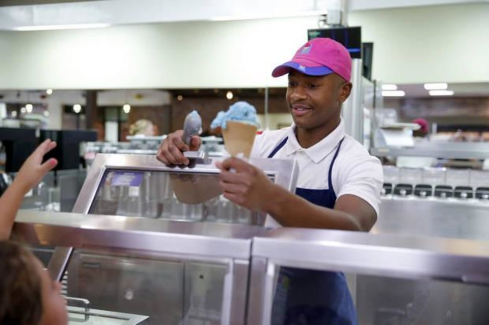Photo -  Angelo Brison, 15, helps a customer inside a Braum's Ice Cream & Dairy Store in Oklahoma City. [Photo by Bryan Terry, The Oklahoman]
